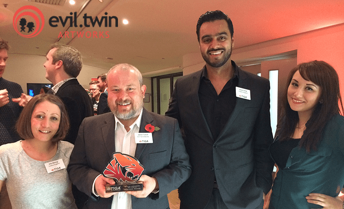 The Evil Twin team presented with a TIGA award at the November ceremony in the OXO Tower, London