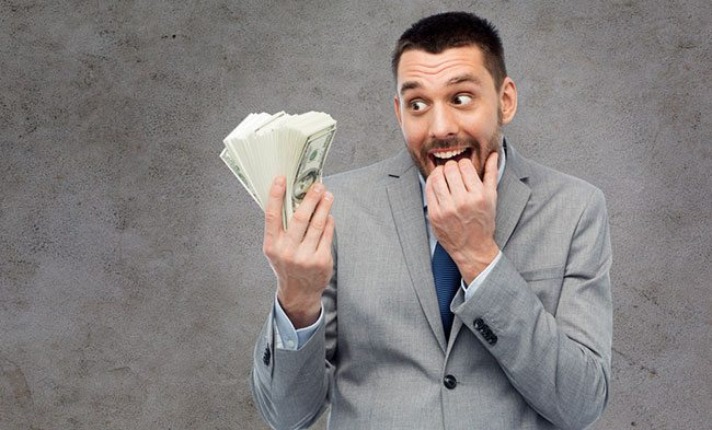 Man holding money wondering whether to take it