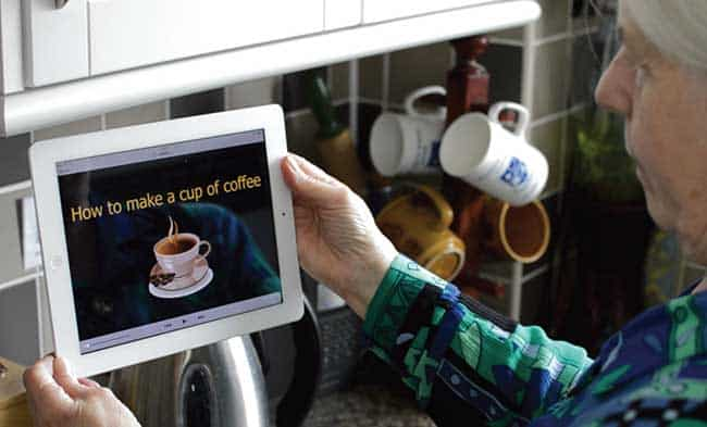 Mock up of Autonome disability tech on ipad held by elderly woman